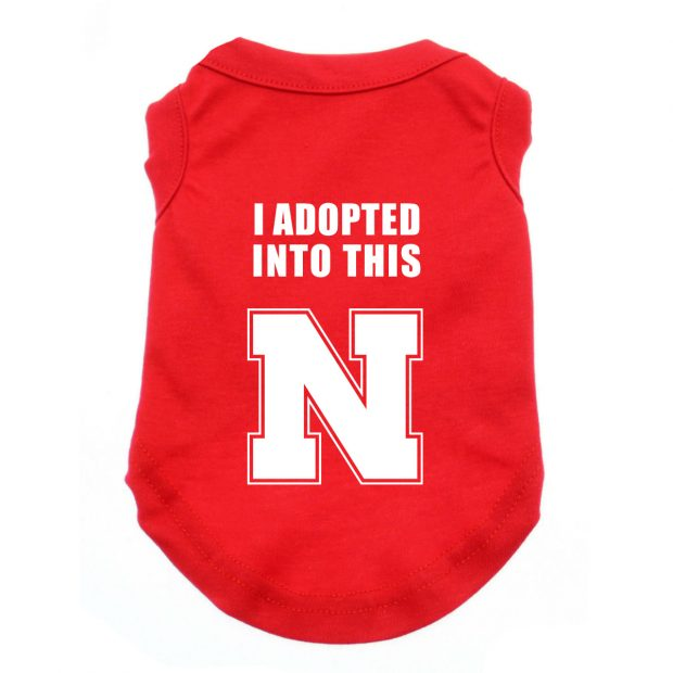 "Malorie isn't a true-blue (red?) Husker fan – she has a Husker shirt that says she ""married into this"" – so we made her dog a matching shirt design"